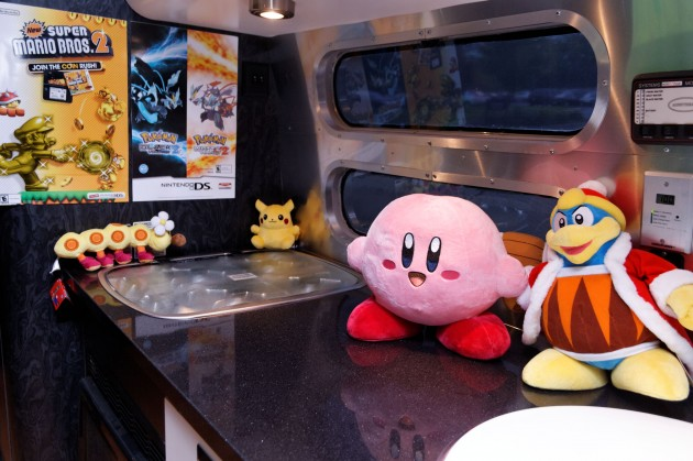 Kirby and King Dedede in the Nintendo Wii U Airstream